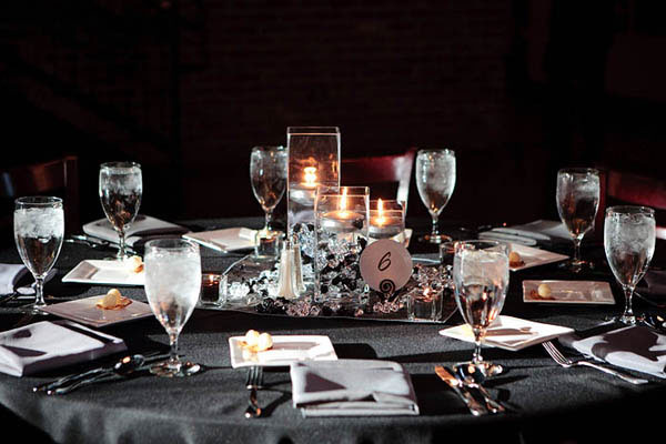 Wedding reception table settings in silver and black