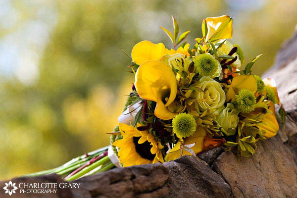 Bouquet of yellow roses, sunflowers, and calla lilies