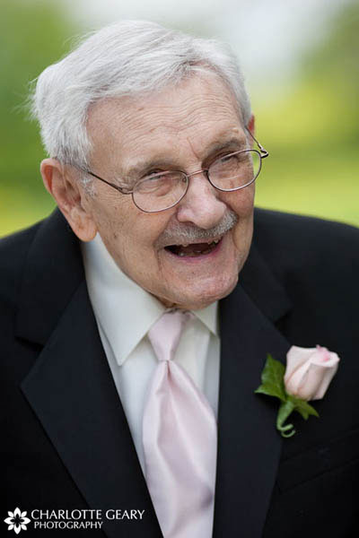 Grandfather in light pink tie and boutonniere