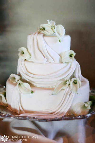 White wedding cake with sugar calla lilies