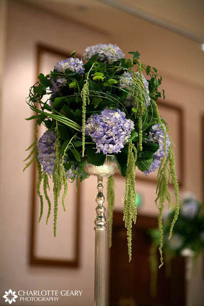 Centerpiece of blue hydrangeas with greenery