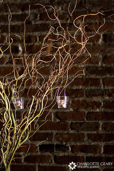 Votive candle hanging from curly willow branches