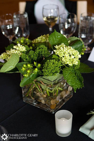 Centerpiece of white flowers in a silver bowl Green wedding centerpiece