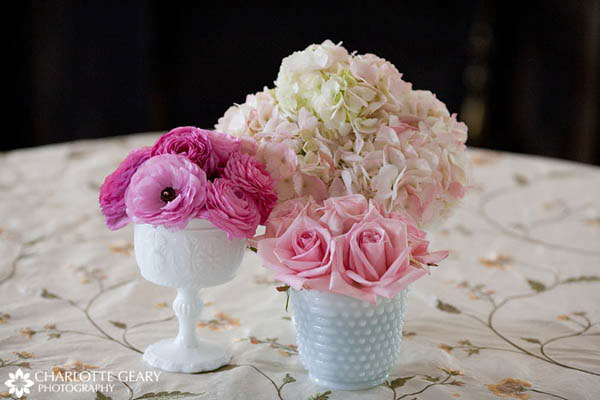 Clusters of pink flowers in white vases