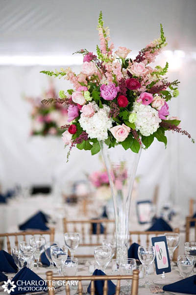 Pink roses and peonies in a tall glass vase