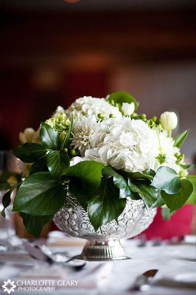 Centerpiece of white flowers in a silver bowl