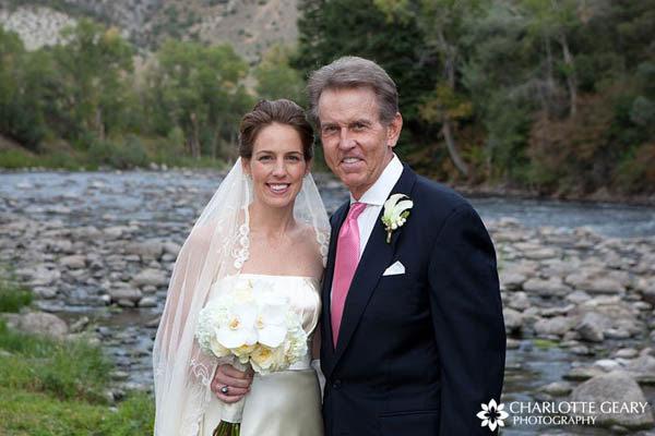 Father of the bride in navy suit with pink tie