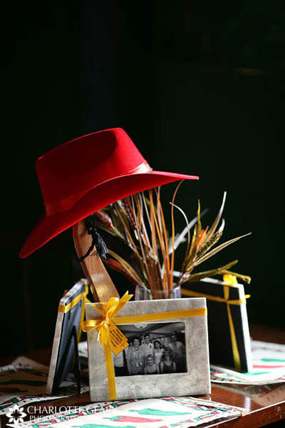 Cowboy-themed wedding centerpiece with framed family photos as party favors