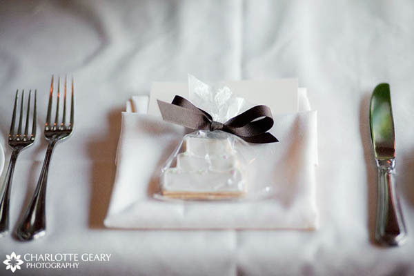 Wedding table setting with sugar cookie wedding favor