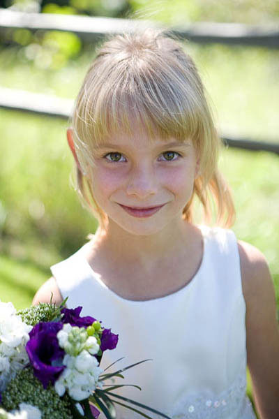 Flower girl with purple flowers