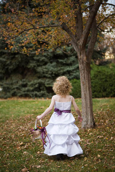 Flower girl with purple sash