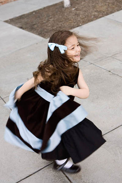 Flower girl in brown and blue dress