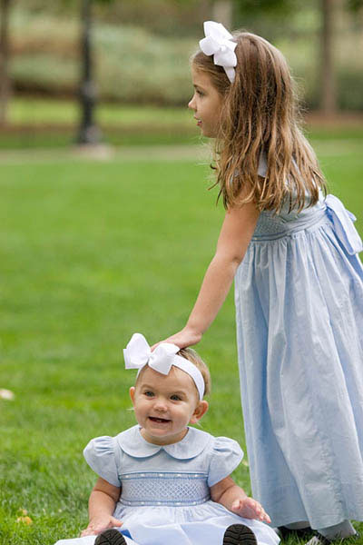 Flower girls in light blue dresses