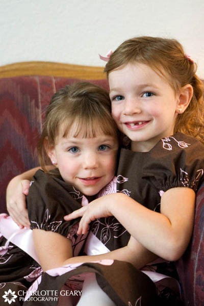 Flower girls in pink and brown dresses