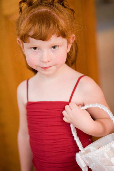 Flower girl in red dress