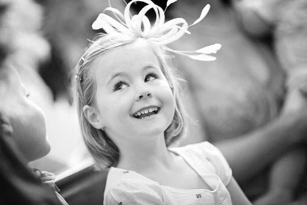 Flower girl with feathers in her hair