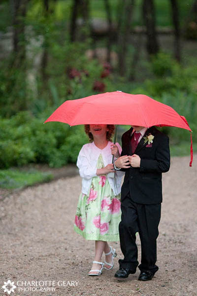 Brother and sister share an umbrella