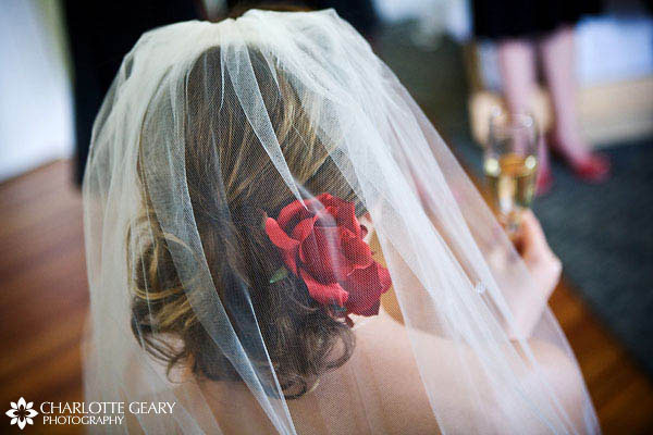 Bride with red flower in her hair