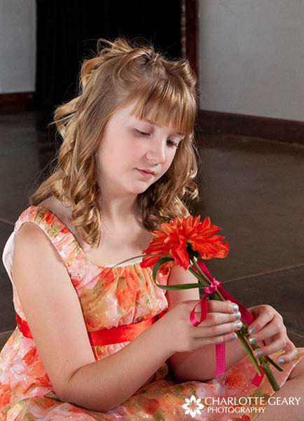 Flower girl with bangs and half-up hairstyle