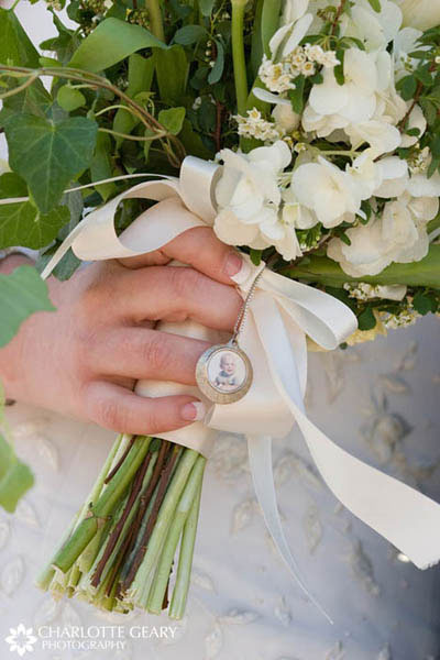 Family locket tied around the bride