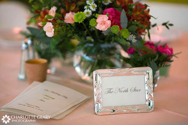 Table number displayed in a silver frame