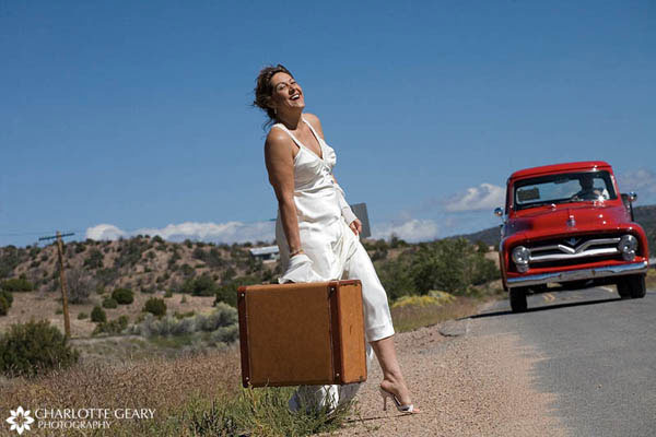 Bride and groom departing in an antique red truck