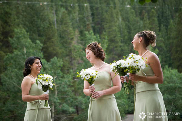 Bridesmaids in celedon green dresses