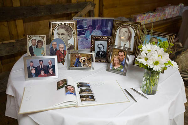 A display of family photographs on the guestbook table