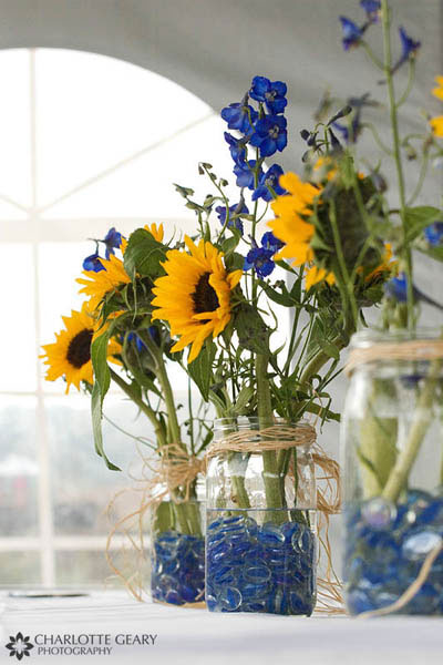 Blue and yellow sunflower centerpieces in mason jars
