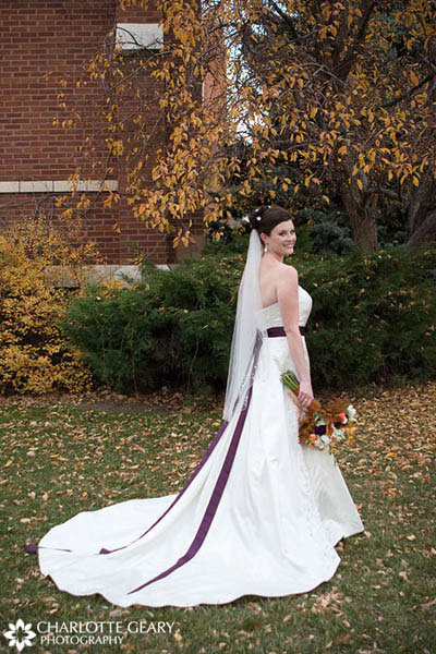 Bride in white dress with purple sash