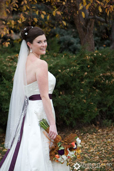 Bride with purple sash and orange and purple flowers