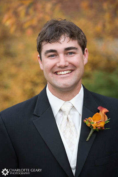 Groom with orange boutonniere