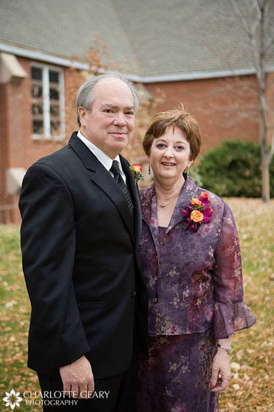 Father and mother of the bride in purple