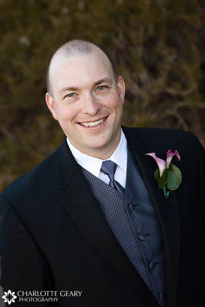 Groom with blue tie and vest and purple calla lily bouquet