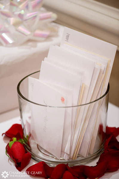 Wedding cards in a glass vase