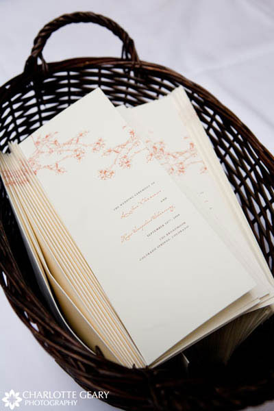Wedding programs with orange leaf illustrations
