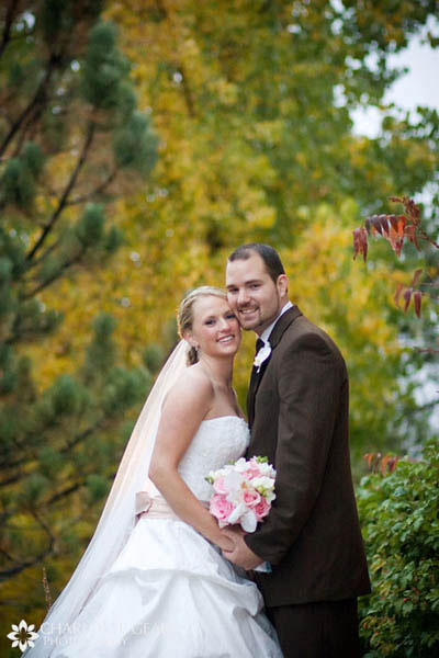 Bride with pink bouquet and groom in chocolate brown suit