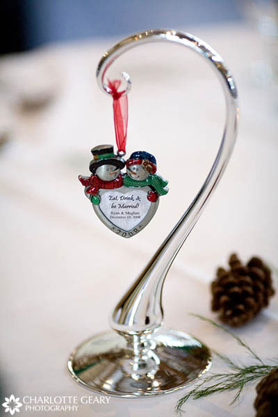 Table number displayed on a Christmas ornament for a winter wedding