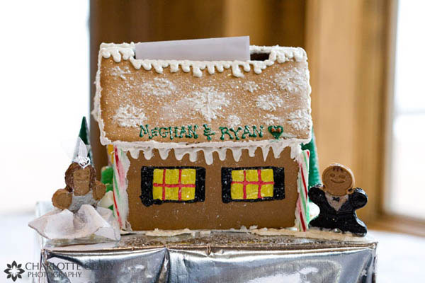 Handmade gingerbread house with a bride and a groom, used as a card box