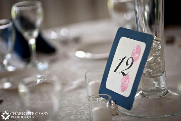 Navy blue table number sign with embossed pink flowers