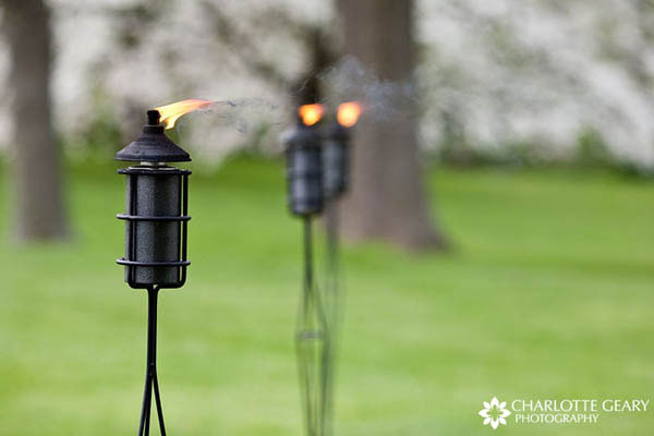 Gas lanterns at an outdoor wedding ceremony