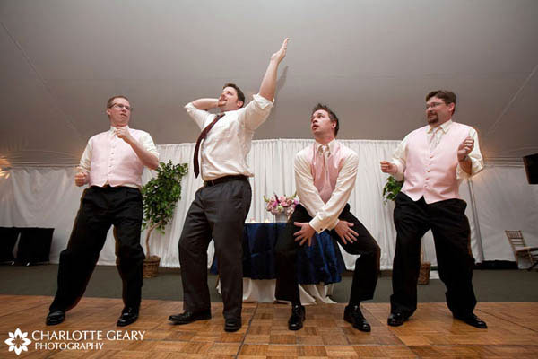 Groomsmen in light pink vests
