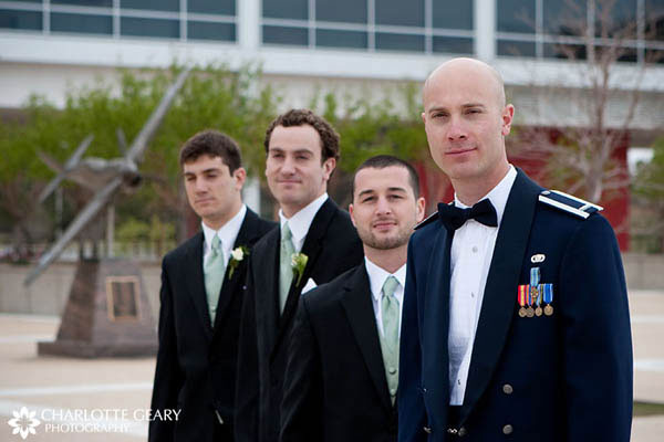 Groom in an Air Force uniform, with his groomsmen in black suits and green ties