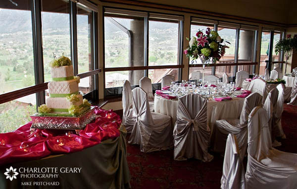 Reception room decorated in pink and green, with champagne colored chair covers