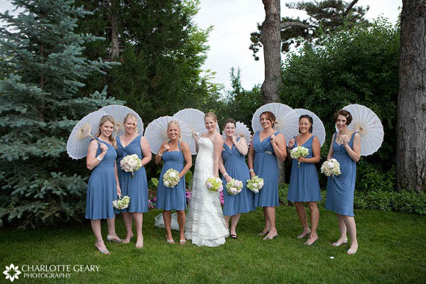 Bridesmaids in blue dresses with parasols