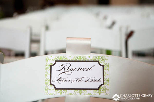 Sign for reserved chairs at wedding ceremony