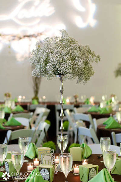 Wedding centerpiece on a tall silver pillar