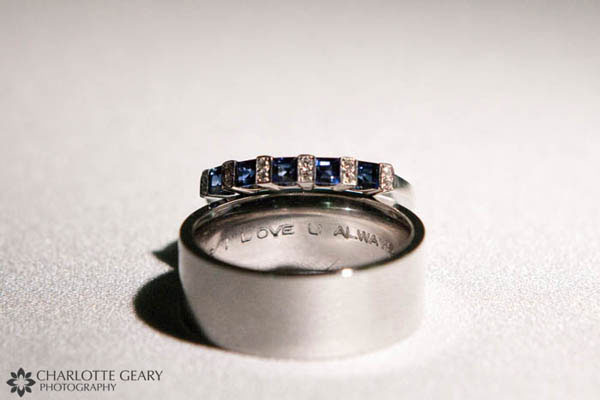 Wedding rings with blue stones and inscription