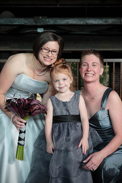 Brides and flower girl in silver dresses