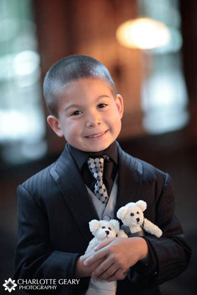 This ring bearer carried teddy bears dressed like the brides instead of a ring pillow.
